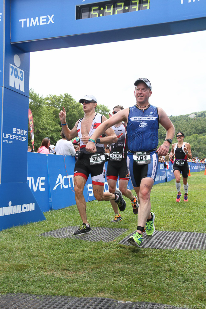 70.3, Endurance Sports, FinisherPix, Half Ironman, Race, Run, Sports, Timberman, Triathlon, finish, finish line, multisport, tri